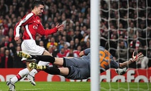 Roma goalkeeper Doni saves a shot from Arsenal's Robin van Persie