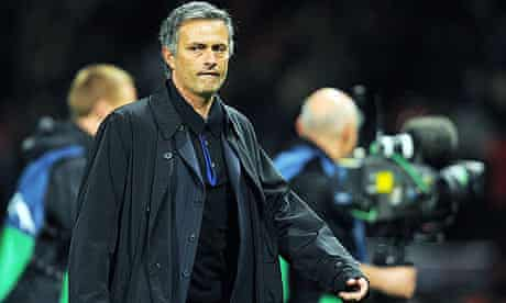 Inter coach Jose Mourinho leaves the field after his team's defeat at Manchester United