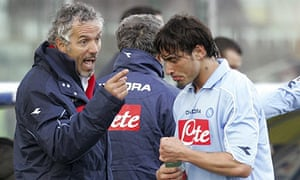 Napoli's new coach Roberto Donadoni, left, gives directions to forward Ezequiel Lavezzi