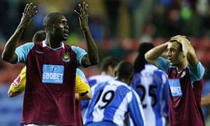 Carlton Cole reacts after his red card