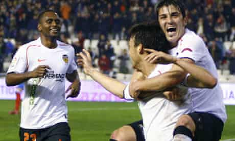 Valencia's David Villa embraces his team-mate David Silva at the Mestalla stadium