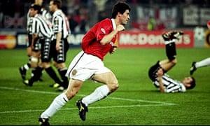 Roy Keane wheels away after scoring at Juve