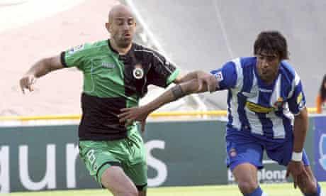 Espanyol's Argentinian midfield Roman Fernando, right, in action against Racing de Santander