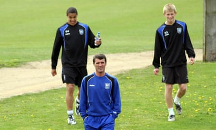 New Ipswich Town manager Roy Keane walks off the training pitch at Ipswich's training ground