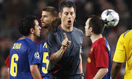 Barcelona's Xavi and Andres Iniesta complain to referee Wolfgang Stark.