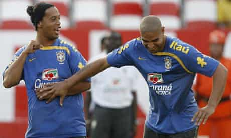 Adriano, seen here with Brazil team-mate Ronaldinho, has not returned to Milan