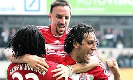 Bayern Munich's Italian striker Luca Toni celebrates scoring with Franck Ribery and Breno