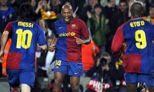 Lionel Messi and Samuel Eto'o go to celebrate with Thierry Henry