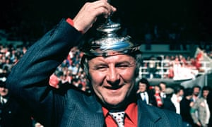 Tommy 'The Doc' Docherty in high spirits following Manchester United's FA Cup win in 1977