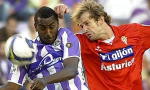 Real Valladolid's Senegalese forward Henok Goitom  vies for the ball with Sporting's Gerard Aute