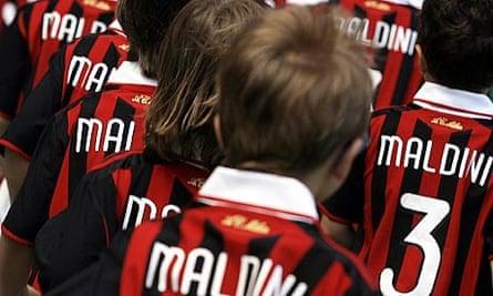 Children wear Milan jerseys bearing the name 'Maldini'