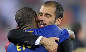 Barcelona coah Pep Guardiola hugs Samuel Eto'o