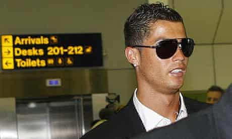 Manchester United's Cristiano Ronaldo arrives back at Manchester airport