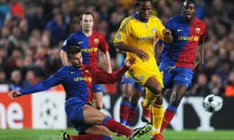 Gerard Piqué of Barcelona tackles Didier Drogba of Chelsea