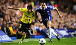 Chelsea's John Terry challenges Barcelona's Lionel Messi