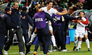Landon Donovan and Benny Feilhaber celebrate with team-mates after Clint Dempsey's goal