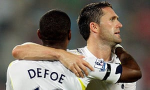 Robbie Keane is congratulated by Jermain Defoe after scoring during Tottenham's Asia Cup final win