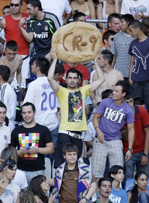 Cristiano Ronaldo: A Real Madrid fan holds up a loaf of bread in tribute to Cristiano Ronaldo