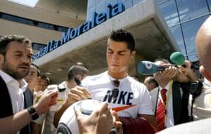 Cristiano Ronaldo: Cristiano Ronaldo signs autographs before his Real Madrid medical