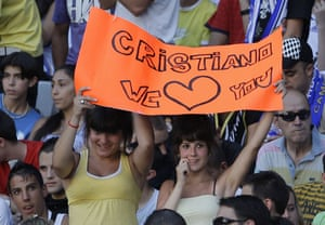 Cristiano Ronaldo: Two Real Madrid fans hold up a banner at Cristiano Ronaldo's unveiling