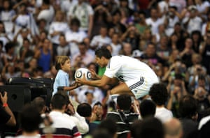 Cristiano Ronaldo: Cristiano Ronaldo gives a ball to a child during his Real Madrid unveiling