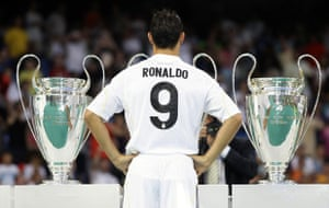 Cristiano Ronaldo: Cristiano Ronaldo poses with Real Madrid's trophies at his unveiling