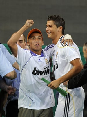 Cristiano Ronaldo: A fan hugs Cristiano Ronaldo after invading the pitch during his unveiling