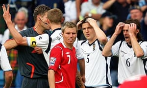 Gary Caldwell of Scotland is sent off