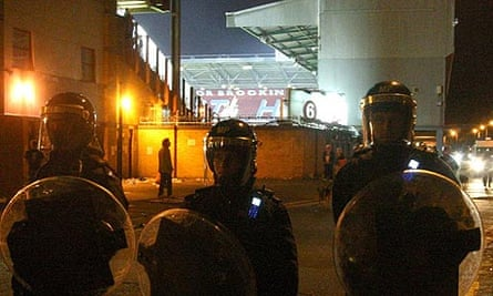 Police officers in riot gear on Priory Road, outside Upton Park