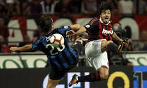 Inter Milan's Chivu fights for the ball with AC Milan's Gattuso