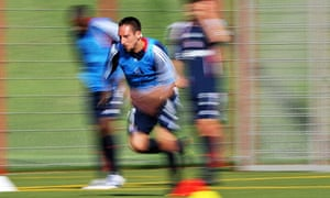 Franck Ribery runs during a training session