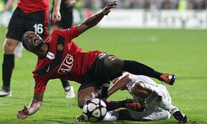 Manchester United's Patrice Evra is fouled by Barbosa Rodrigo Tabata