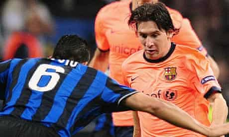 Lionel Messi fights for the ball