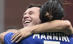 Sampdoria's Daniele Mannini celebrates with his Antonio Cassano