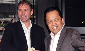Bryan Robson shakes hands with the Thai FA chief Worawi Makudi