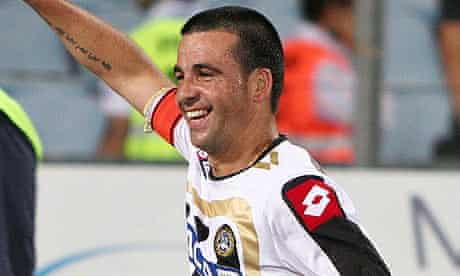 Udinese's Antonio Di Natale celebrates scoring against Milan