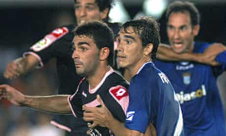 Xerez defender Francis, right, vies with Deportivo forward Adrian