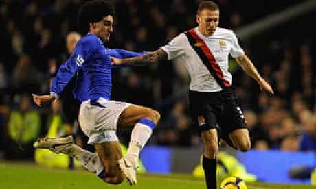 Marouane Fellaini tackles Craig Bellamy during Everton's win over Manchester City
