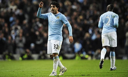 Carlos Tevez gestures to Gary Neville, Manchester City v Manchester United