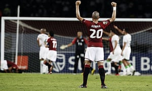Egypt's Wael Gomaa raises his arms in celebration after his team took a 1-0 lead