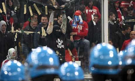 Serbia fans challenge Italian police prior to kick-off