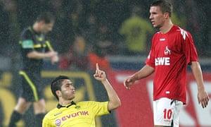 Dortmund's Nuri Sahin celebrates scoring in front of Lukas Podolski