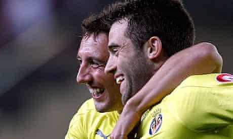 Villarreal's Giuseppe Rossi, right, celebrates and Santi Cazorla after scoring against Atletico