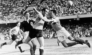 Uruguay's Miguez gets to the ball first during Scotland's 7-0 shellacking at the 1954 World Cup