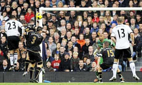 Clint Dempsey scores the first of his two goals for Fulham against Wigan Athletic in their 2-0 win