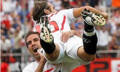 Sevilla defender Fernando Navarro celebrates with Diego Capel