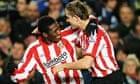 Asamoah Gyan celebrates with Jordan Henderson