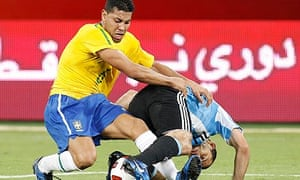 Brazil's Andre Dos Santos fights for the ball with Argentina's Javier Mascherano