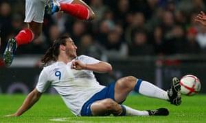 France's Yann M'Vila and England's Andy Carroll