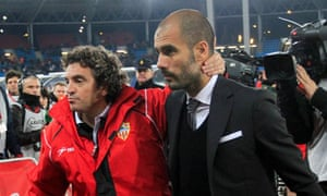 Almeria's coach Juanma Lillo embraces Pep Guardiola